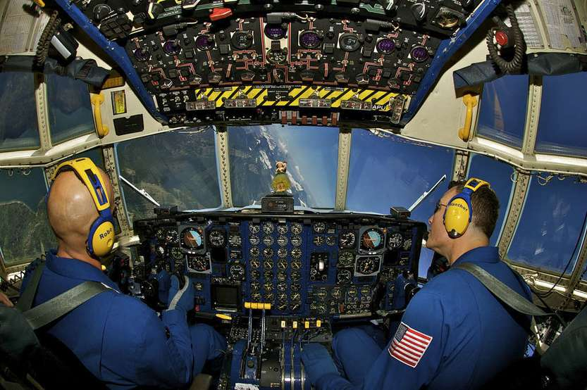 Marine pilots with the Blue Angels perform a bank over Glacier National Park