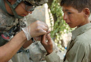 10th Mountain Medic treats Afghan boy