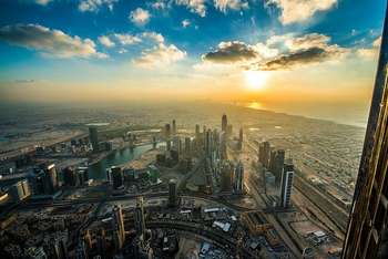 Dubai Sunset from Burj Khalifa - photo by Simon Bierwald