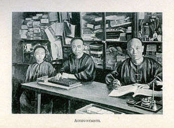 Chinese accountants at work in their store